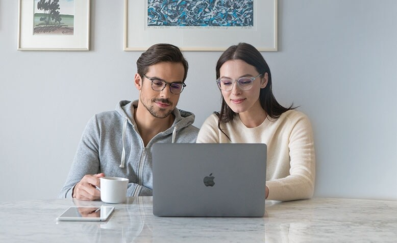 Man and woman with SightRelax glasses